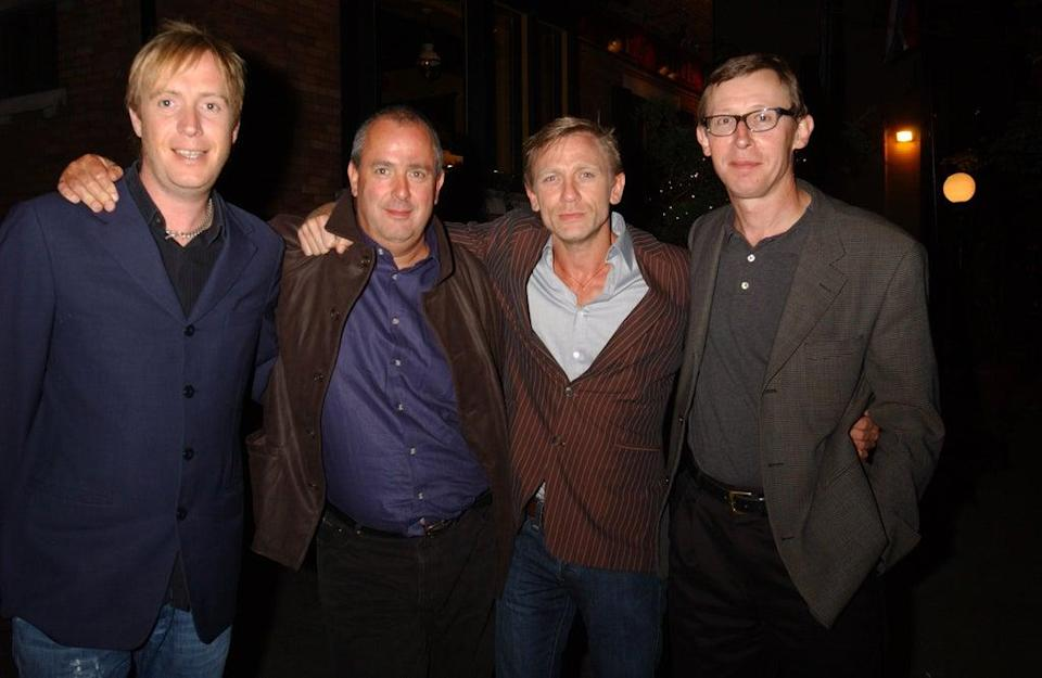 Michell with Rhys Ifans, Daniel Craig and Kevin Loader (WireImage)