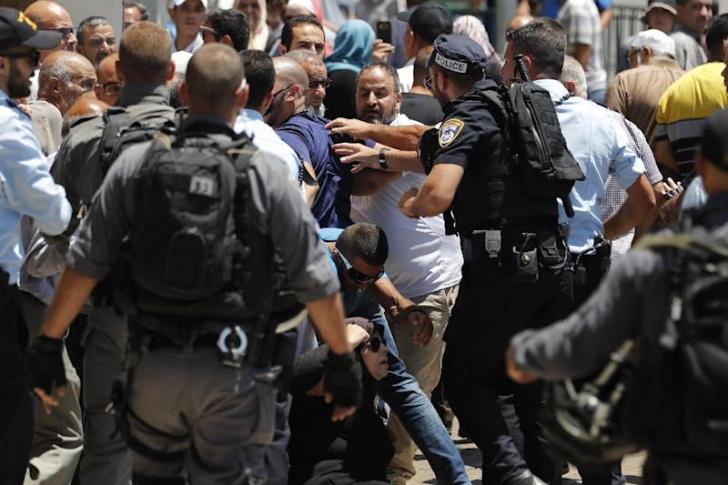 Israeli security forces scuffle with Palestinians outside Damascus Gate, a main entrance to Jerusalem's Old City, on July 14, 2017, as they attempt to enter the area, following a shooting