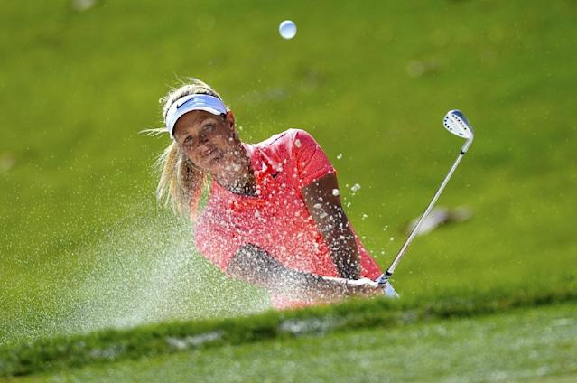 Suzann Pettersen of Norway makes a shot out of a bunker on the eight hole during the third round of the ANA Inspiration, on the Dinah Shore Tournament Course at Mission Hills Country Club in Rancho Mirage, California, on April 1, 2017 (AFP Photo/Robert Laberge)