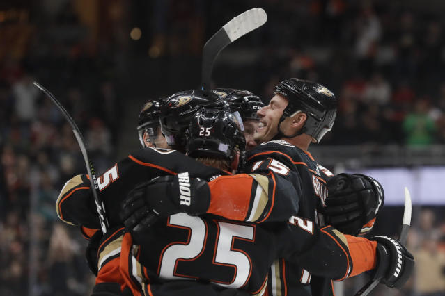 Anaheim Ducks center Ryan Getzlaf, right, celebrates a goal by Cam Fowler during the second period of an NHL hockey game against the Detroit Red Wings in Anaheim, Calif., Tuesday, Nov. 12, 2019. (AP Photo/Chris Carlson)