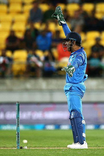 MS Dhoni guiding his team around on the cricket field