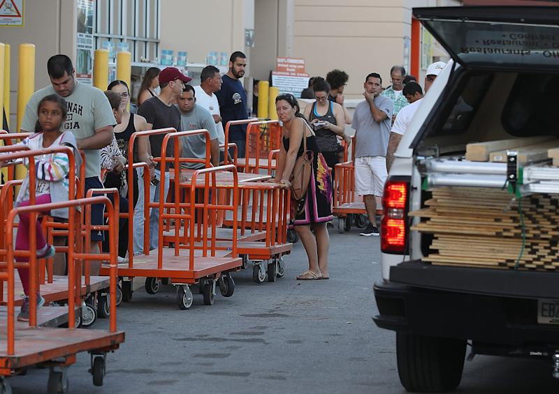 People wait in line to purchase plywood at Home Depot in Miami as they prepare for Hurricane Irma on Sept. 6, 2017. (Joe Raedle / Getty Images)