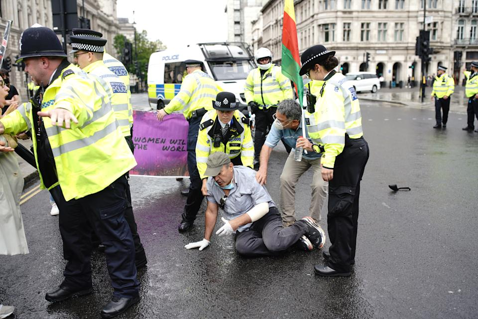 Police detain a man after he ran in front of Prime Minister Boris Johnson's car as it left the Houses of Parliament, Westminster. The man, who had been demonstrating about Turkey's operation against Kurdish rebels in northern Iraq, was taken into the Palace of Westminster by officers. (Photo by Aaron Chown/PA Images via Getty Images)