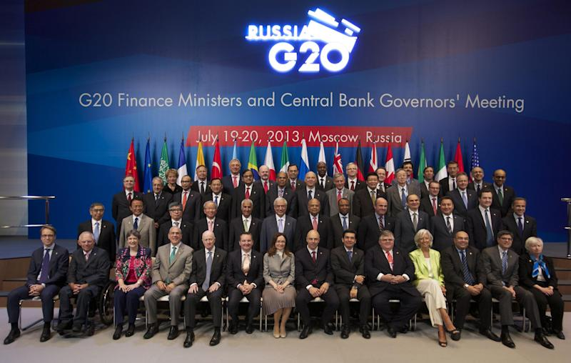 Finance ministers and central bank chiefs pose for a group photo following a meeting of the Group of 20 finance ministers in Moscow, Russia, Saturday, July 20, 2013. Stashing profits offshore may soon get tougher for companies, thanks to an ambitious plan released Friday by the finance chiefs of leading world economies aimed at forcing multinationals to pay more taxes. (AP Photo/Alexander Zemlianichenko)