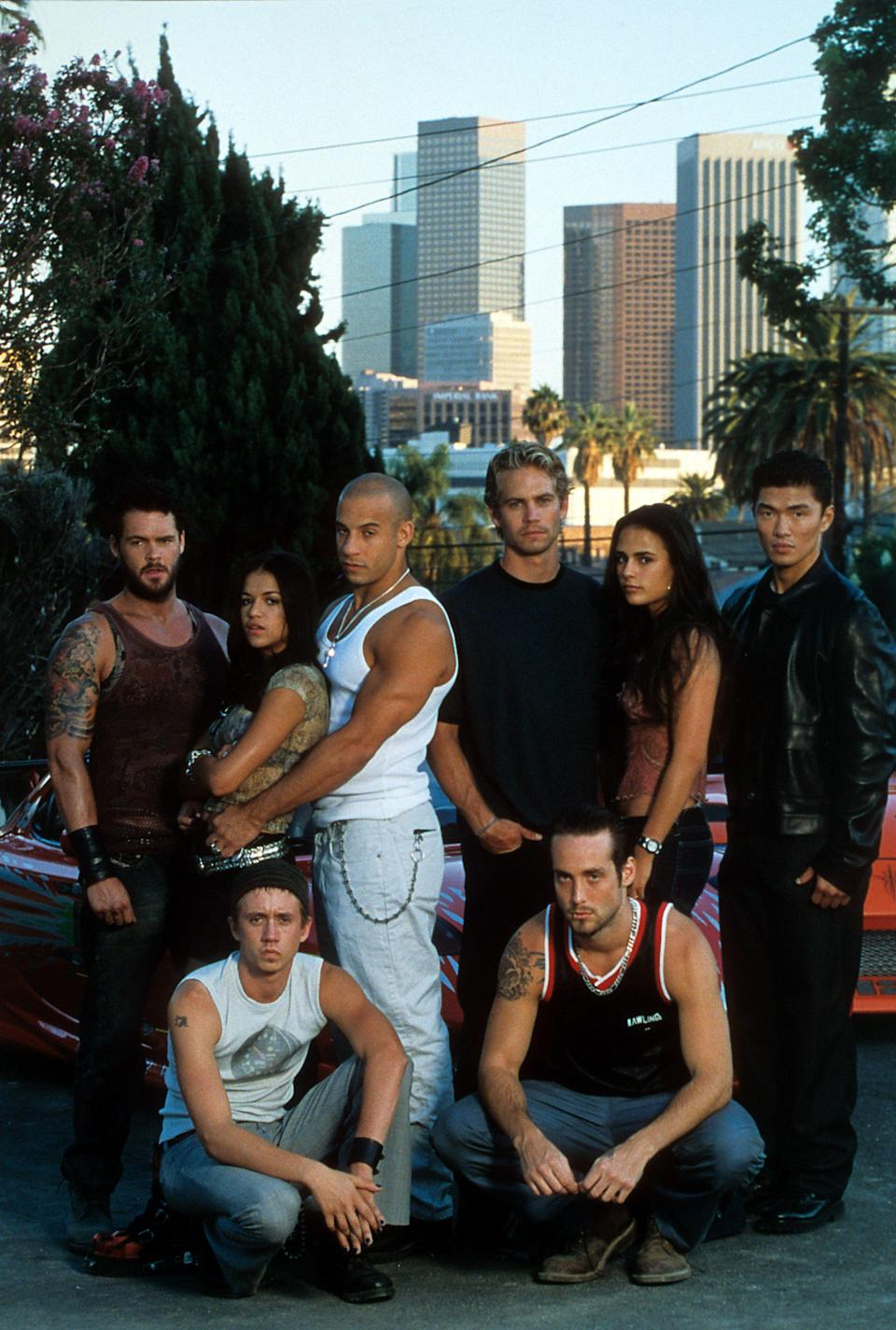 """<p>Whether you're a die-hard <em><a href=""""https://www.esquire.com/entertainment/movies/g28580600/fast-and-the-furious-movies-ranked/"""" rel=""""nofollow noopener"""" target=""""_blank"""" data-ylk=""""slk:Fast & Furious"""" class=""""link rapid-noclick-resp"""">Fast & Furious</a> </em>fan or you just really love Vin Diesel, there's no denying that <em>The Fast and the Furious </em>franchise has delivered quality action films for the past two decades. The success isn't just due to the stunts. The <a href=""""https://www.esquire.com/entertainment/movies/a32619058/justin-lin-f9-fast-and-furious-han-back-interview/"""" rel=""""nofollow noopener"""" target=""""_blank"""" data-ylk=""""slk:chemistry between the characters"""" class=""""link rapid-noclick-resp"""">chemistry between the characters</a> (and actors) makes the series compelling, but there's an unexpected sense of heart that may be from the real-life bonds made over the years. (The heartwarming sentiments after <a href=""""https://www.esquire.com/entertainment/movies/a36832748/paul-walker-brian-oconner-fast-and-furious-9-blue-nissan/"""" rel=""""nofollow noopener"""" target=""""_blank"""" data-ylk=""""slk:Paul Walker's death"""" class=""""link rapid-noclick-resp"""">Paul Walker's death</a> and the reappearance of former cast members in sequel after sequel speak to that.) But just how far have they come from their first <em>Fast and Furious </em>film? We're tracking down the original cast members and our favorites throughout the series for a look at <em>The Fast and the Furious</em> stars, then and now. </p>"""