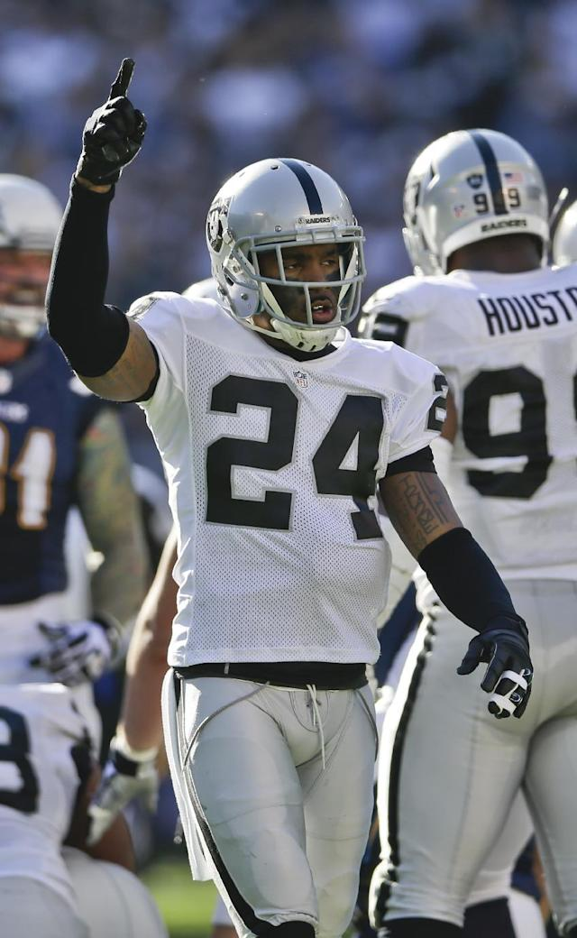 Oakland Raiders free safety Charles Woodson celebrates a Raiders' fumble recovery during the first half of an NFL football game against the San Diego Chargers on Sunday, Dec. 22, 2013, in San Diego, CA.. (AP Photo/Lenny Ignelzi)