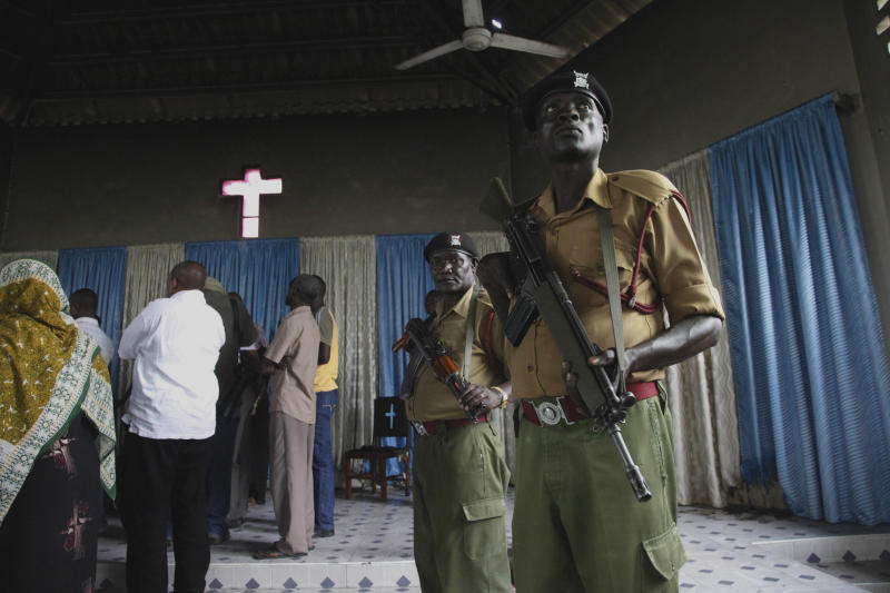Kenyan riot police officers stand guard Wednesday, Aug. 29, 2012 after religious leaders and area member of parliament Ali Hassan Joho visited a church in Kisauni north Mombasa, which was destroyed my Muslim youth followed the death of a controversial Muslim preacher Aboud Rogo Mohammed. Muslim cleric Aboud Rogo Mohammed who was sanctioned by the U.S. and U.N. for his alleged support for an al-Qiada-linked militant group, was shot to death by unknown gunmen Monday morning in his car as he drove family members including his five-year-old daughter who was unharmed.  (AP Photo/Sayyid Azim)