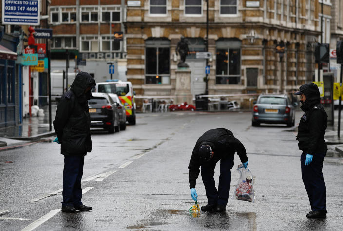 <p>A police officer carries an evidence bag as he works with colleagues on Borough High Street, close to Borough Market, in London on June 6, 2017, as the police investigations continue following the June 3 terror attack. (Photo: Odd Andersen/AFP/Getty Images) </p>