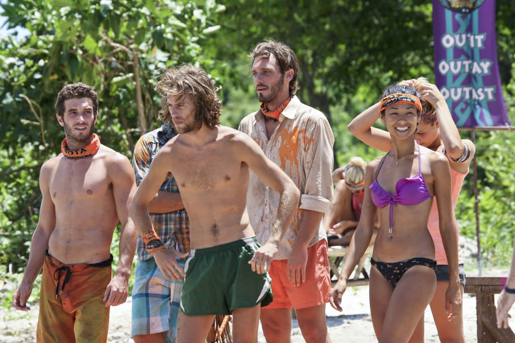 """Tubby Lunchbox"" - Edward ""Eddie"" Fox, Erik Reichenbach and Brenda Lowe ofthe Gota Tribe lines up before the Immunity Challengeduring the seventh episode of ""Survivor: Caramoan - Fans vs. Favorites."""
