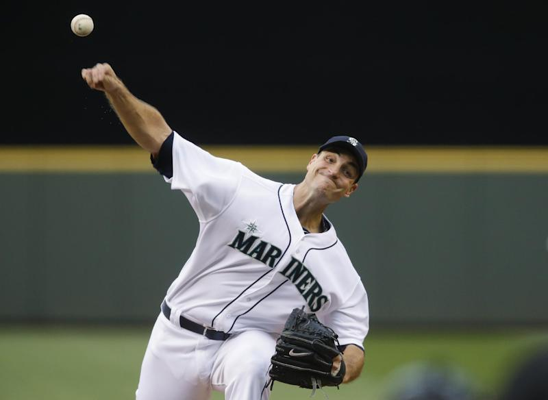 Seattle Mariners starting pitcher Chris Young throws against the New York Yankees in the fourth inning of a baseball game, Wednesday, June 11, 2014, in Seattle. (AP Photo/Ted S. Warren)