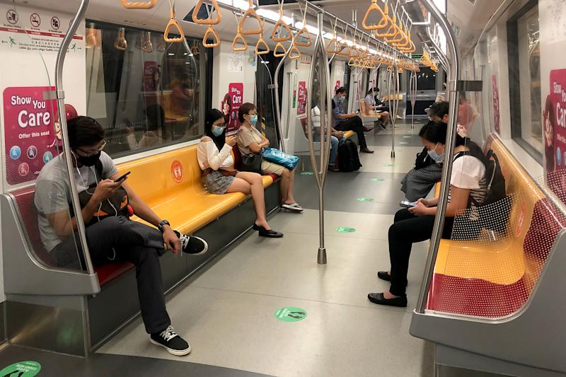 Commuters in face masks seen aboard a Downtown Line MRT train. (PHOTO: Dhany Osman / Yahoo News Singapore)