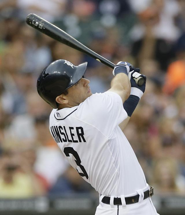 Detroit Tigers' Ian Kinsler hits a sacrifice fly off Cleveland Indians starting pitcher Trevor Bauer during the third inning of a baseball game in Detroit, Friday, July 18, 2014. (AP Photo/Carlos Osorio)