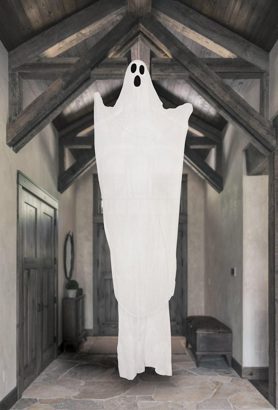 <p>Give a spooky welcome to trick-or-treaters with this <span>Way to Celebrate Halloween Hanging Ghost Decoration</span> ($10). It's eerie, creepy, and such a great find for a haunted house.</p>