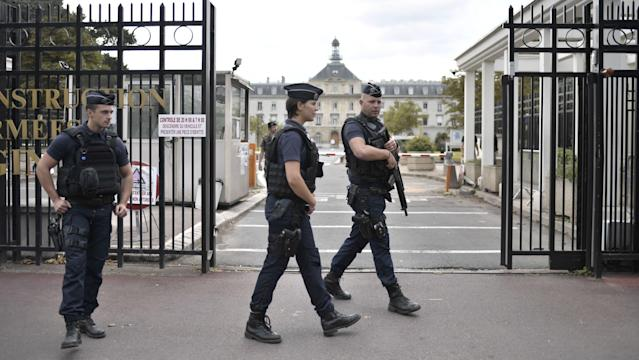 <p>Armed French police officers stand at the entrance of the Begin Military Teaching Hospital in Saint-Mande, outside Paris, on August 9, 2017, where the French soldiers injured earlier in the morning in Levallois-Perret are being treated. (Photo: Stephane de Sakutin/AFP/Getty Images) </p>