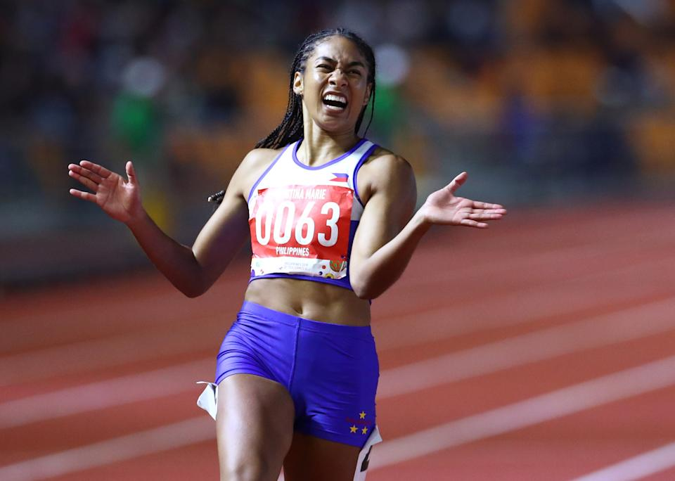 Southeast Asian Games - Athletics - New Clark Athletic Stadium, Capas, Philippines - December 7, 2019    Philippines' Knott Kristina Marie celebrates after winning the women's 200m final   REUTERS/Athit Perawongmetha