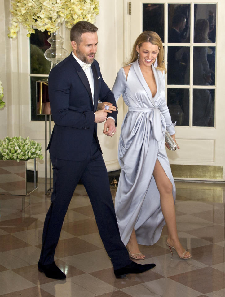 <p>The actress opted for a plunging silk wrap dress for a dinner at the White House in honour of the Canadian prime minister's visit. She teamed the look with statement earrings and an embellished clutch.<i> [Photo: Getty]</i></p>