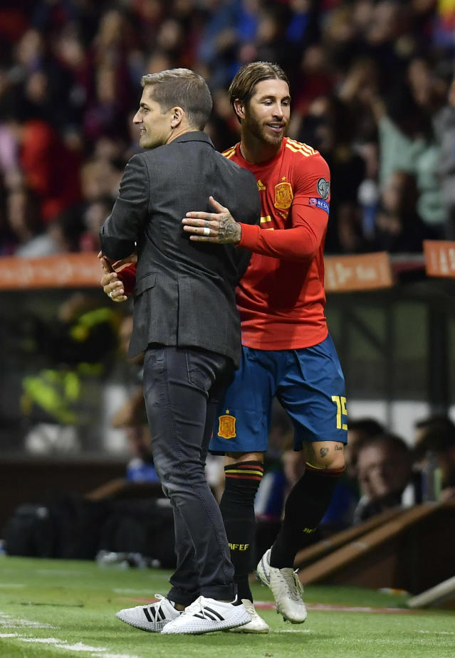 Spain's Sergio Ramos, right and Spain's coach Roberto Moreno embrace after Ramos was substituted during the Euro 2020 group F qualifying soccer match between Spain and Faroe Islands at the Molinon, stadium in Gijon, Spain, Sunday, Sept. 8, 2019. (AP Photo/Alvaro Barrientos)