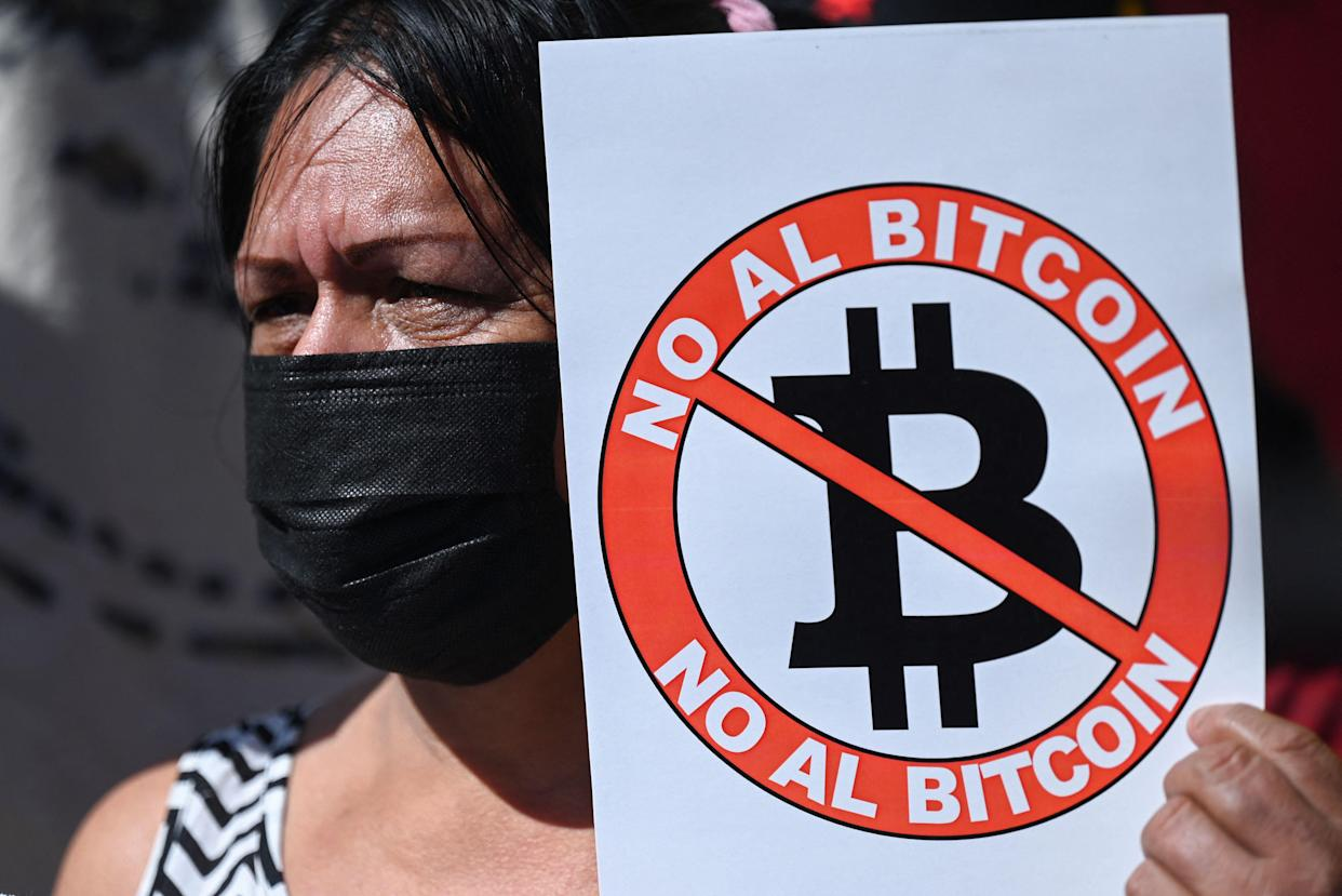 A woman holds a banner that reads