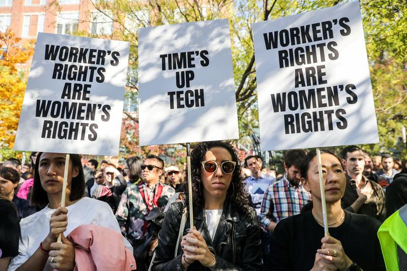 FILE PHOTO: Workers hold signs outside 14th Street Park across the Google offices after walking out as part of a global protest over workplace issues in New York