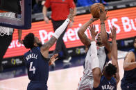 Washington Wizards guard Bradley Beal, top right, shoots under pressure from Minnesota Timberwolves guard Jaylen Nowell (4) and forward Josh Okogie, bottom right, during the first half of an NBA basketball game, Saturday, Feb. 27, 2021, in Washington. (AP Photo/Nick Wass)