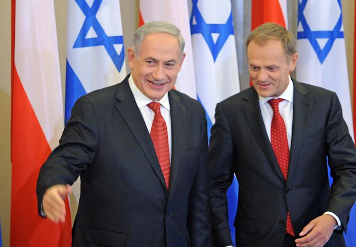 Israeli Prime Minister Benjamin Netanyahu, left, and his Polish counterpart Donald Tusk walk for talks in Warsaw, Poland, Wednesday, June 12, 2013. Netanyahu came to Poland for a two day visit for talks with Tusk and to attend the opening of a Holocaust exhibition in the former German Nazi Death Camp Auschwitz Birkenau. (AP Photo/Alik Keplicz)