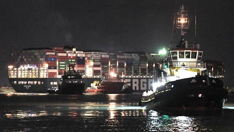 Tug boats working on the Ever Given on Saturday night