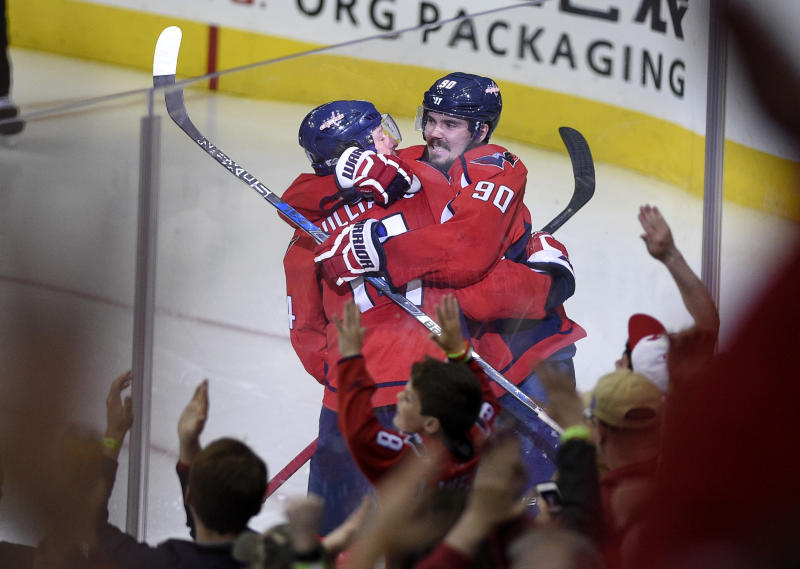 Washington Capitals right wing Justin Williams (14) celebrates his winning goal with center Marcus Johansson (90), of Sweden, in the overtime period of Game 5 in an NHL Stanley Cup hockey first-round playoff series against the Toronto Maple Leafs, Friday, April 21, 2017, in Washington. (AP Photo/Nick Wass)