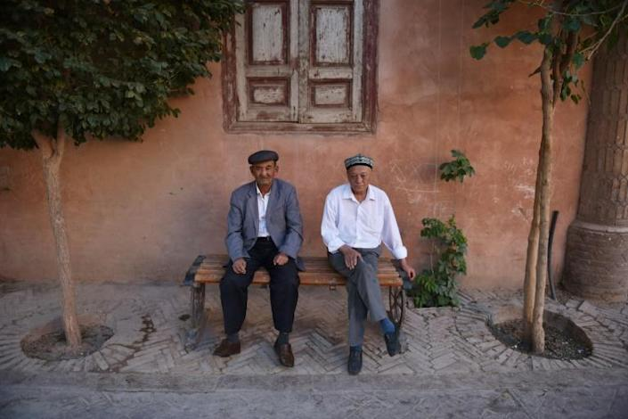 Armed police and frequent checkpoints have not dampened the flow of vacationers visiting Xinjiang, which in 2018 saw a 40 percent increase year-on-year of visits -- outstripping the national average by 25 percent, according to China's official figures (AFP Photo/GREG BAKER)