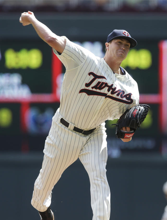 Minnesota Twins pitcher Kyle Gibson throws against the Cleveland Indians in the first inning of a baseball game, Wednesday, Aug. 14, 2013 in Minneapolis. (AP Photo/Jim Mone)