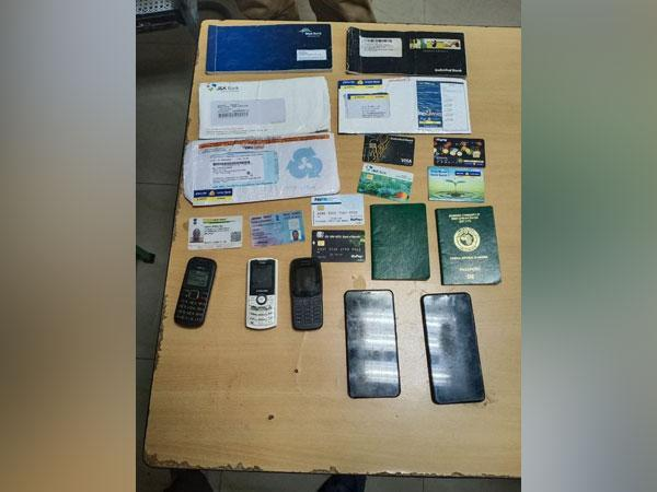 Police recovered five mobile phones, six ATM cards and five cheque books from the Nigerian national on Friday. [Photo/ANI]