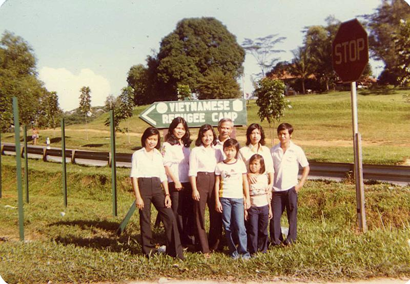 11-year-old Heather Stenseng (third from right) with her extended family and friends at the former refugee camp at Hawkins Road in Sembawang, Singapore in 1981. Everyone in the photo was eventually resettled in the United States. PHOTO: Heather Stenseng