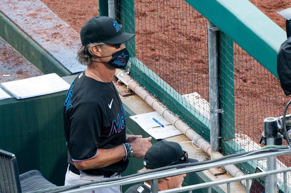 Miami Marlins' manager Don Mattingly looks out from the dugout during the eighth inning of a baseball game against the Philadelphia Phillies, Saturday, July 25, 2020, in Philadelphia.