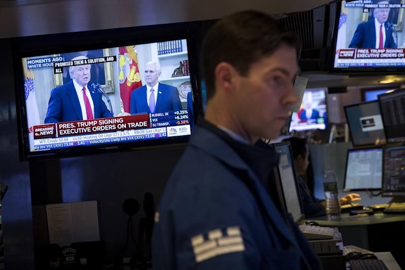 President Donald Trump is displayed on television monitors as traders work and financial professionals work on the floor of the New York Stock Exchange (NYSE). (Drew Angerer/Getty Images)