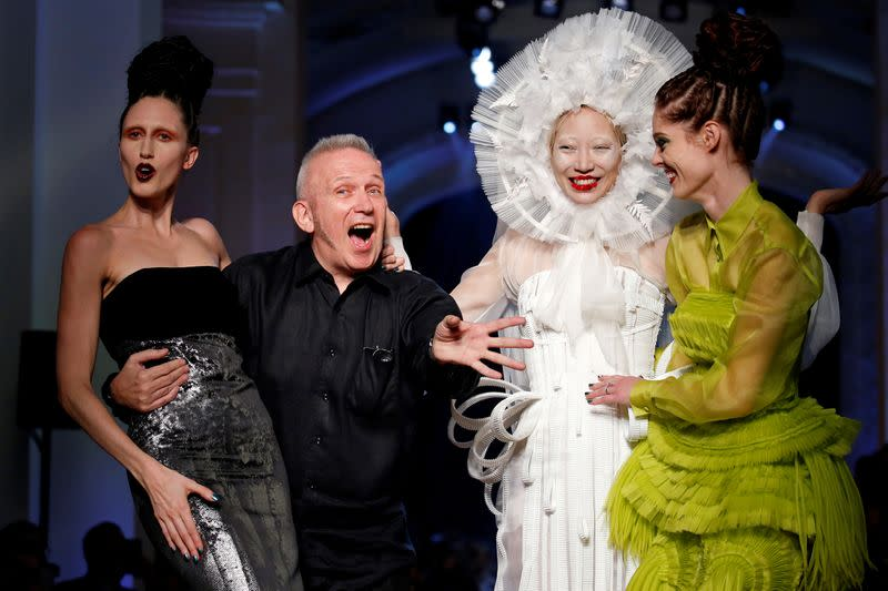 FILE PHOTO: French designer Jean Paul Gaultier appears with models at the end of his Haute Couture Fall/Winter 2016/2017 collection in Paris