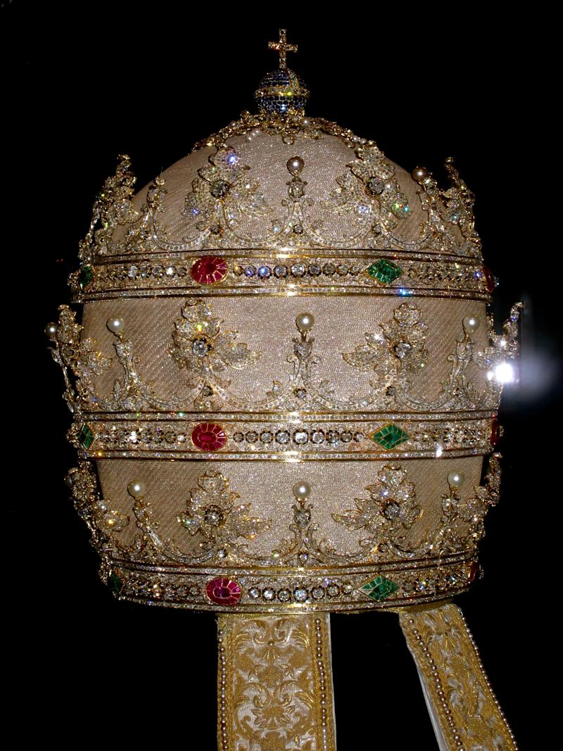 Tiara of Pius IX (reigned 1846–78). German and Spanish, 1854. Cloth of silver embroidered with gold metal thread, gold, diamonds, rubies, sapphires, emeralds, and pearls.