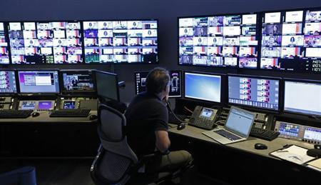 "A technician works in the ""Acquisition Room"", which receives televison feeds from around the world, during an event to mark the opening of the new Univision and Fusion television networks newsroom in Doral"