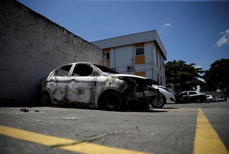 A burnt car in which a body was found during searches for the Greek Ambassador for Brazil Kyriakos Amiridis, is pictured at a police station in Belford Roxo, Brazil December 30, 2016. REUTERS/Ricardo Moraes