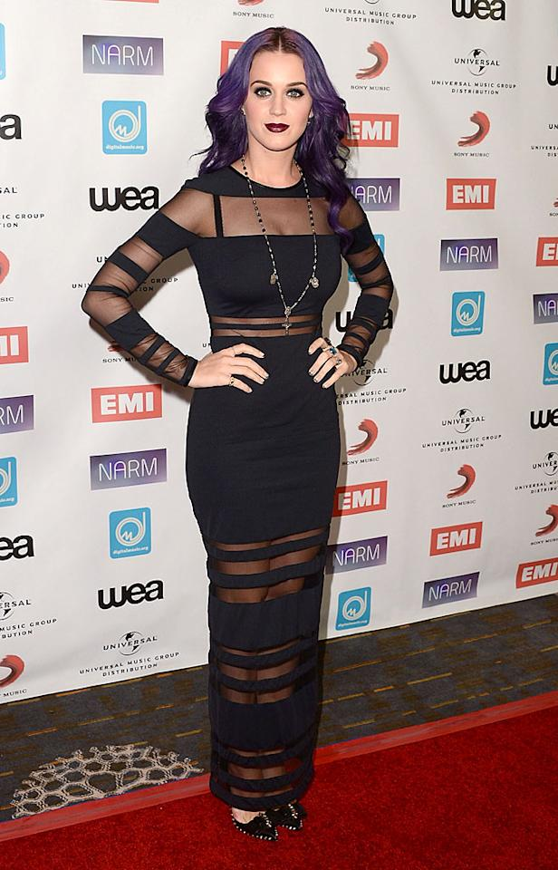Speaking of spooky, check out this Elvira-esque look singer Katy Perry showed up in at the NARM Music Biz Awards on Thursday evening. Knowing that Russell Brand's ex constantly changes her appearance and doesn't play by the rules, she'll likely be back in a pink polka dot bikini come Halloween. (5/10/2012)