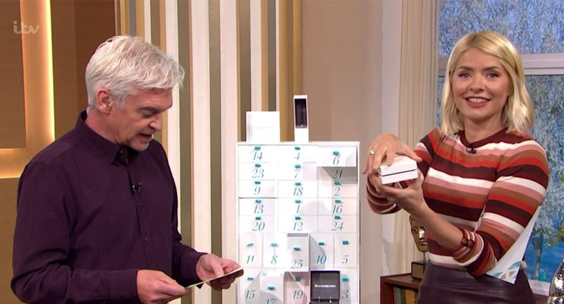 Holly Willoughby wears a £27 jumper from Warehouse on This Morning today [Photo: ITV]