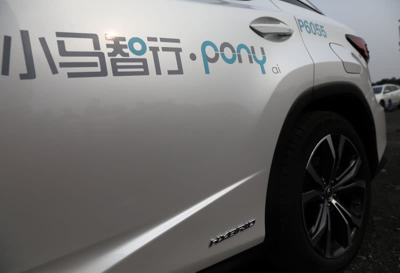 Logo of Pony.ai is seen on a Lexus vehicle equipped with the company's autonomous driving system, in Beijing