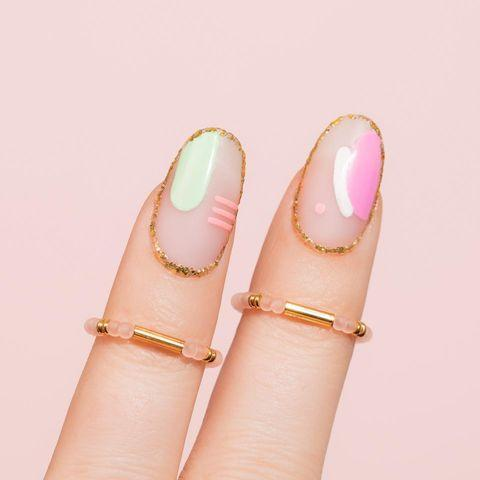 """<p>Random swoops, streaks and dabs of color look purposeful and very Miami cool when outlined in a thin ribbon of gold sparkle.</p><p><a href=""""https://www.instagram.com/p/CNk6dWGrpnT/"""" rel=""""nofollow noopener"""" target=""""_blank"""" data-ylk=""""slk:See the original post on Instagram"""" class=""""link rapid-noclick-resp"""">See the original post on Instagram</a></p>"""