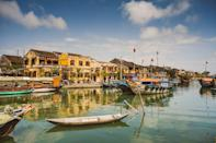 """Whether you're interested in historic architecture, delicious food, or scenic landscapes, Hoi An is the <a href=""""https://www.cntraveler.com/story/how-to-take-your-vietnam-trip-to-the-next-level?mbid=synd_yahoo_rss"""" rel=""""nofollow noopener"""" target=""""_blank"""" data-ylk=""""slk:Vietnamese"""" class=""""link rapid-noclick-resp"""">Vietnamese</a> destination for you. Honored as the ninth friendliest city in the world by our readers, the ancient port city has a relaxed pace of life that's appealing to both locals and travelers. One major reason why? Most motor traffic is banned from the well-preserved Old Town, a UNESCO World Heritage Site, making it all the better for the pedestrians who stroll the streets to take in the 15th- to 19th-century architecture. (You can see much of that architecture because Hoi An, unlike many Vietnamese cities, escaped largely unscathed from bombing during the Vietnam War)."""