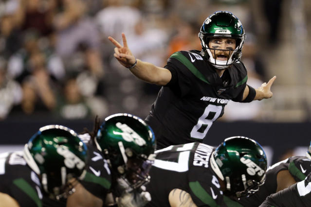 FILE - In this Monday, Sept. 16, 2019, file photo, New York Jets' quarterback Luke Falk signals at the line of scrimmage during the second half of an NFL football game against the Cleveland Browns in East Rutherford, N.J. Falk was merely a practice squad quarterback a week ago. But with Sam Darnold still sidelined by mononucleosis and Trevor Siemian out for the season with an ankle injury, he is the Jets' starting quarterback, and against the New England Patriots, of all opponents. (AP Photo/Adam Hunger, File)