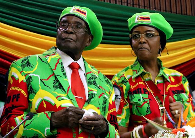 <p>Zimbabwean President Robert Mugabe and his wife Grace attend a meeting of his ruling ZANU PF party's youth league in Harare, Zimbabwe, Oct. 7, 2017. (Photo: Philimon Bulawayo/Reuters) </p>