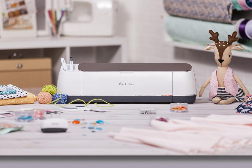 cricut maker on table with crafts