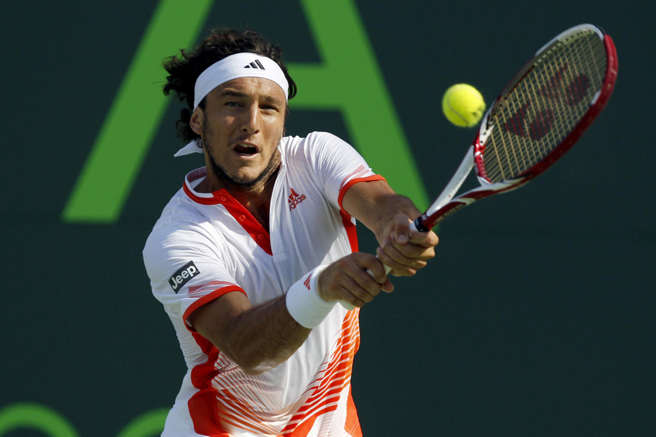 Juan Monaco, of Argentina, returns the ball to Mardy Fish during the Sony Ericsson tennis tournament, Thursday, March 29, 2012, in Key Biscayne, Fla. (AP Photo/Lynne Sladky)