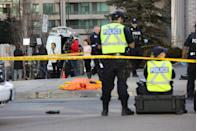<p>A body lies on the pavement covered in an orange tarp after several people were killed and injured in a deadly van attack in Toronto. Creative Touch Imaging Ltd./NurPhoto </p>