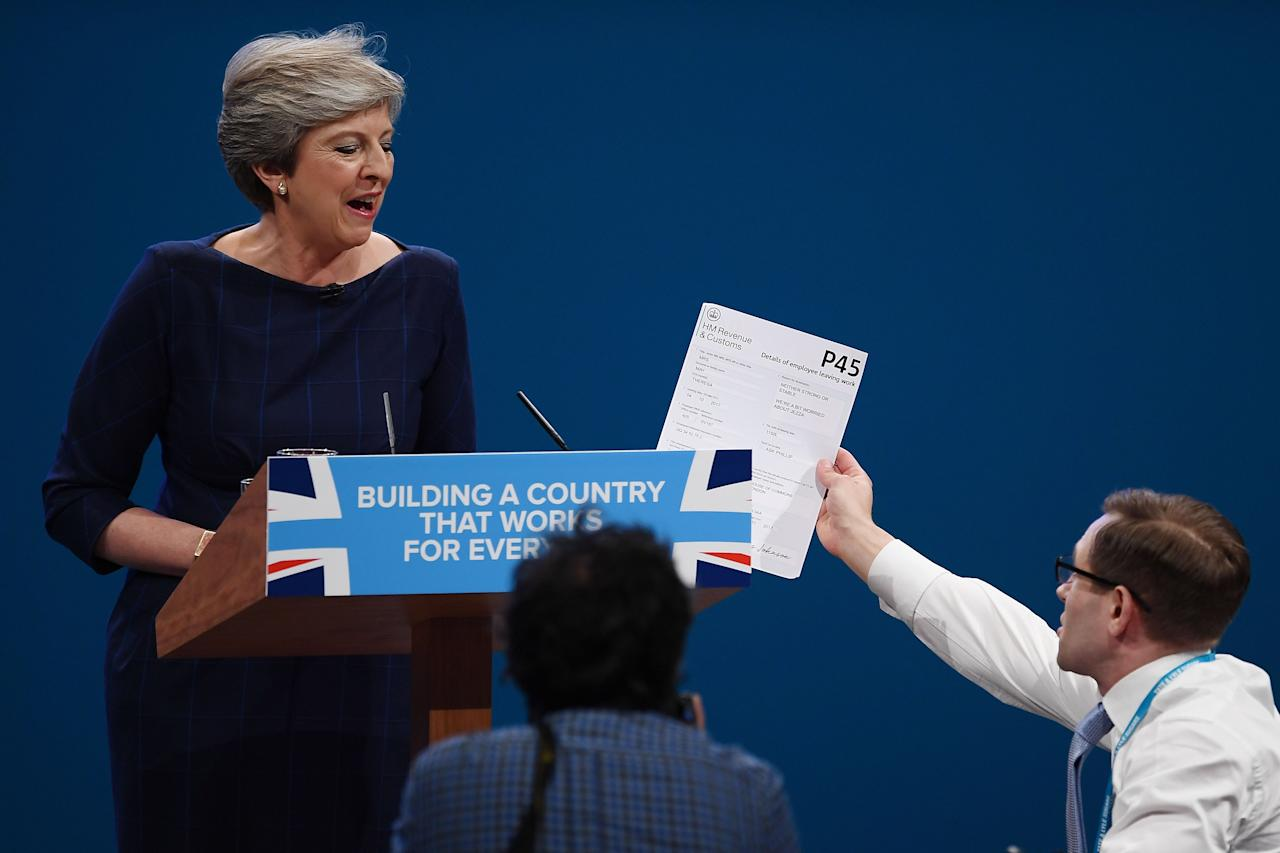 "<p>British Prime Minister Theresa May delivers her keynote speech to delegates and party members on the last day of the Conservative Party Conference at Manchester Central on October 4, 2017 in Manchester, England. The prime minister rallied members and called for the party to ""shape up"" and ""go forward together"". Theresa May also announced a major programme to build council houses and a cap on energy prices. </p>"