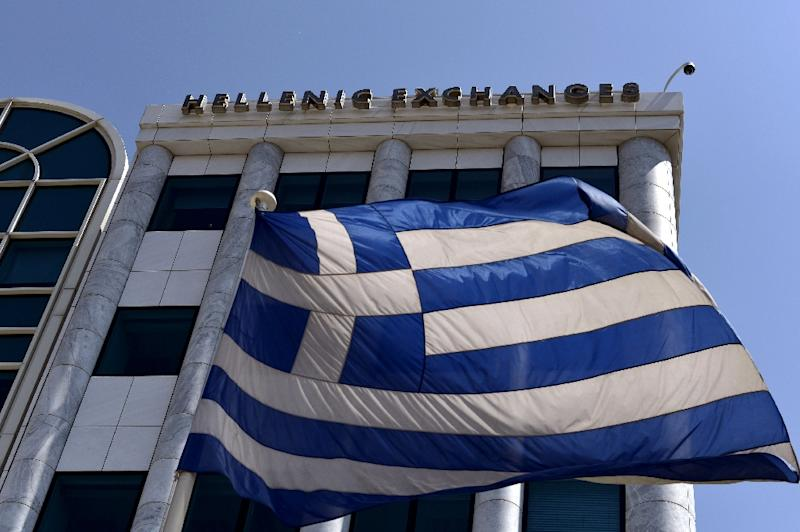 Greece is struggling to deliver on fresh reforms that are needed to unlock a further 2.8 billion euros ($3 billion) in bailout loans (AFP Photo/Aris Messinis)