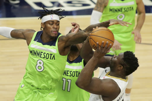 Minnesota Timberwolves forward Jarred Vanderbilt (8) defends against New Orleans Pelicans forward Zion Williamson (1) in the second quarter during an NBA basketball game, Saturday, Jan. 23, 2021, in Minneapolis. (AP Photo/Andy Clayton-King)